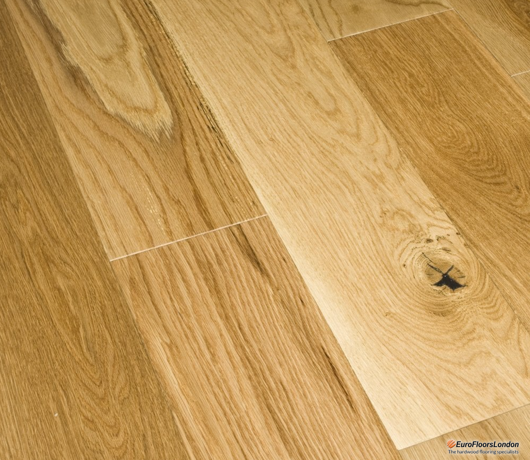 engineered wood flooring planks. in a natural light brown lacquered finish